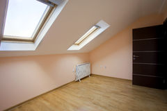 Loft Room. Interior of an empty new loft room with two roof windows royalty free stock image