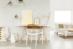 Loft studio with a workspace stock photography