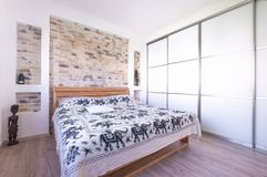 Loft style designed bedroom with double bed, build in wardrobe,