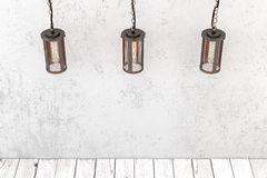 Loft style industrial pendant lamp on a background of a rough wa Stock Image
