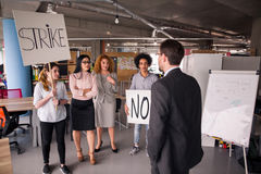 Loft style modern office, employees striking. Royalty Free Stock Photos