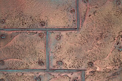 Loft style old metal texture, copper plates on rivets. Copper plates on rivets. Old metal texture of Loft style royalty free stock photography