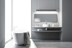 Loft white bathroom with a tub and a sink. Interior of a gray bathroom with a concrete floor, a large window with a cityscape, a white bathtub and a round sink royalty free illustration