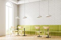 Loft white brick restaurant corner, green sofa Stock Photos