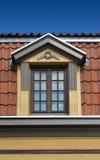 Loft Window. Beautiful window in the loft attic coated with terracotta Stock Photos
