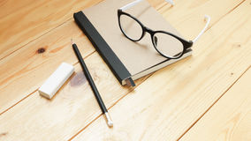 Loft workspace with stationaries on wooden table. Royalty Free Stock Photography