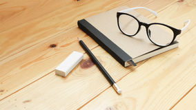 Loft workspace with stationaries on wooden table. Writer and creative work desk royalty free stock image