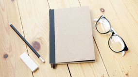 Loft workspace with stationaries on wooden table. Stock Photos