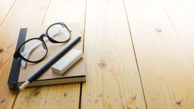 Loft workspace with stationaries on wooden table. Royalty Free Stock Photos
