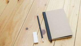 Loft workspace with stationaries on wooden table. Stock Image