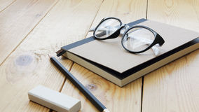 Loft workspace with stationaries on wooden table. Stock Photography