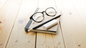 Loft workspace with stationaries on wooden table. Royalty Free Stock Image