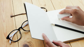 Loft workspace with stationaries on wooden table. Stock Images