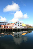 Lofts of the harbour of Kabelvoag mirroring Royalty Free Stock Photos