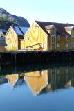 Lofts mirroring in the  harbour of Nusfjord Royalty Free Stock Photos