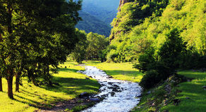 Lofty mountains and flowing water Stock Image