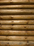 Log background. The side of a log building Stock Images