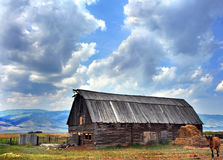 Log Barn and Landscape Scene Royalty Free Stock Photography