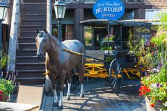 Log Barn 1912  Throwback Roadside Attraction horse with gig Royalty Free Stock Image