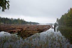 Log boom floating Stock Images