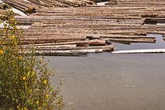 Log boom on lake Stock Photo
