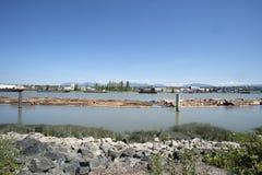 Log boom on lazy river Stock Photos