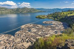Log Booms on Okanagan Lake with Kelowna British Columbia Canada in the Background Royalty Free Stock Image