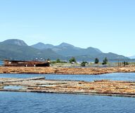 Log Booms, Sayward, British Columbia. On the east coast of Vancouver Island, BC, Canada, logging remains one of the main industries. Tug-type boats push and stock images