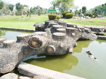 Log bridge. Old log decorated to be seats and bridge across a moat Royalty Free Stock Photo