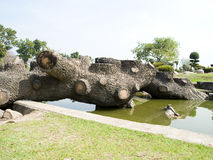 Log bridge. Old log decorated to be seats and bridge across a moat Royalty Free Stock Image