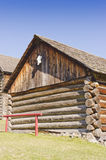 Log building and hitching post Royalty Free Stock Photos