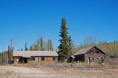 Log Buildings Northway Junction Alaska. Abandoned log lodge buildings at Northway Junction, Alaska on the Alaska Highway stock photo