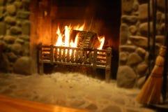Log burning in stone fireplace stock image