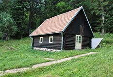 Log cabin. In the woods. Hunting lodge. Forester house Stock Photos