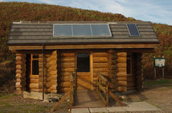 Log Cabin. A modern log cabin with solar panels. used as tourist information Stock Photo