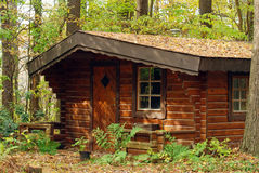 Log cabin. In the forest in autumn Royalty Free Stock Images