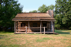 Log cabin. A log cabin in a rural or country setting Stock Photography