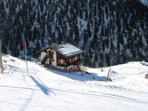 A log cabin in the Alps. By the ski slopes royalty free stock photo