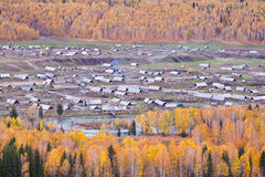 A log cabin area village in the autumn Stock Image