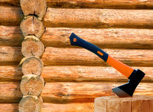 Log cabin and axe Stock Photography