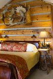 Log cabin with bed Royalty Free Stock Photos