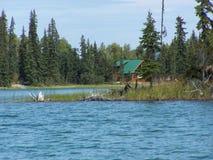 Log cabin behind the island Stock Photo