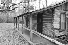 Log cabin in black and white Stock Image