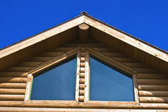 Log cabin with a blue sky Stock Images
