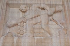 Log Cabin Builder Bas-Relief. The Log Cabin Builder Bas-Relief over the entrance to Buffalo City Hall Royalty Free Stock Image