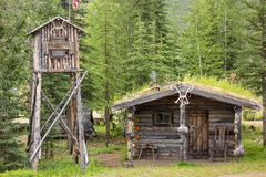A log cabin and cache in alaska stock photography
