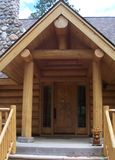 Log Cabin Carving. Large log cabin entranceway with  adeer carved into the door Royalty Free Stock Image