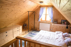 Log cabin cozy rustic interior view Stock Photos