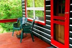 Log cabin deck royalty free stock image