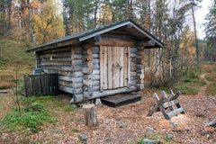 Log Cabin in Deep Taiga Forest Stock Photos